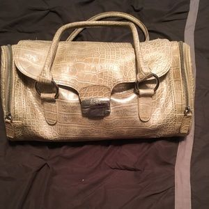 BCBG reptile print bag with 3 side compartments